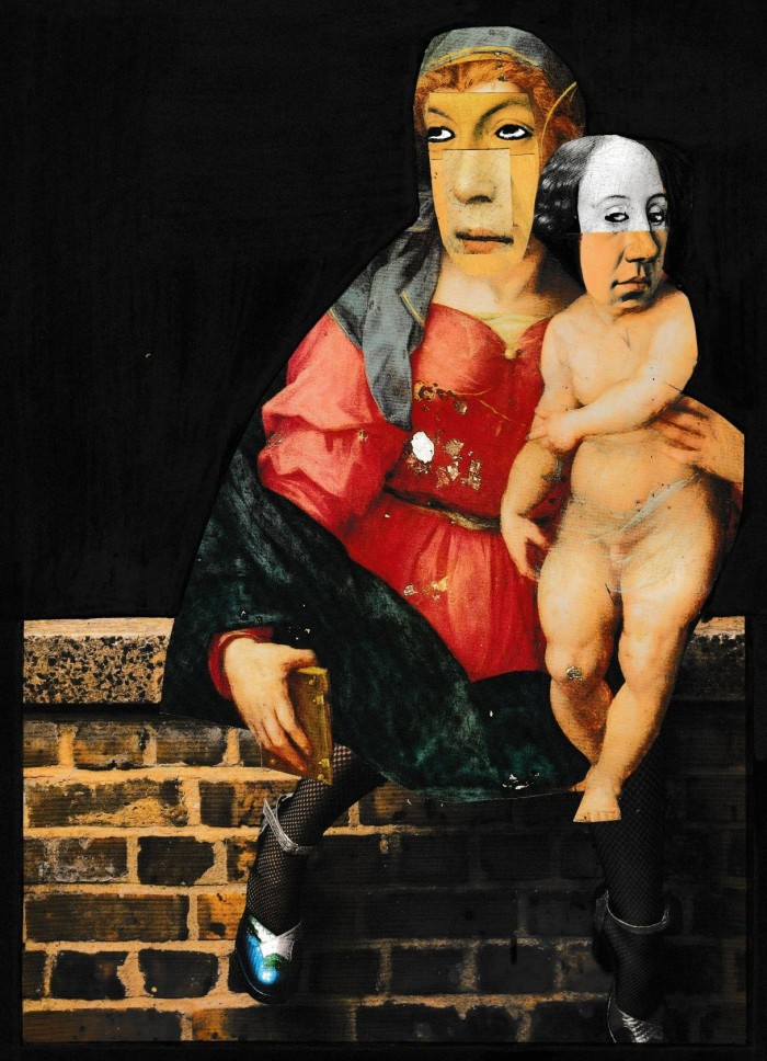 Mother And Baby Sitting On A Wall